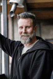 man smiling - we buy houses cleveland ohio